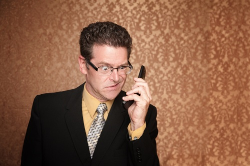 Angry Business Man Hears Something Annoying on His Phone